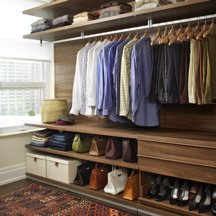 Example of a trendy walk-in closet design in Toronto