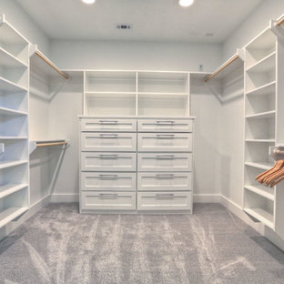 Mid-sized trendy gender-neutral carpeted walk-in closet photo in Houston with white cabinets and shaker cabinets