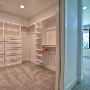 Inspiration for a contemporary closet remodel in Houston with white cabinets