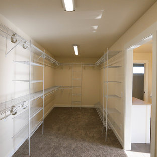 Large country carpeted walk-in closet photo in Other