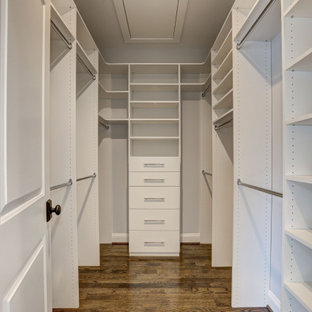 Inspiration for a country walk-in wardrobe in DC Metro with dark hardwood floors.