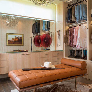 Inspiration for a mid-sized midcentury men's walk-in wardrobe in Austin with flat-panel cabinets, porcelain floors and light wood cabinets.
