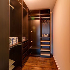 Modern Closet by Redstone Builders