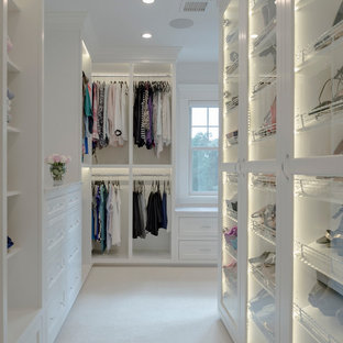 Inspiration for a large modern women's walk-in wardrobe in Boston with open cabinets, white cabinets, carpet and beige floor.
