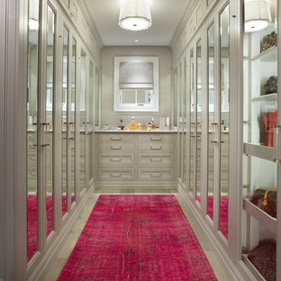 Transitional women's walk-in wardrobe in Phoenix with recessed-panel cabinets and grey cabinets.