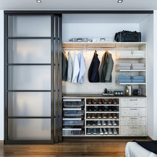 Example Of A Mid Sized Minimalist Men S Reach In Closet Design Los Angeles