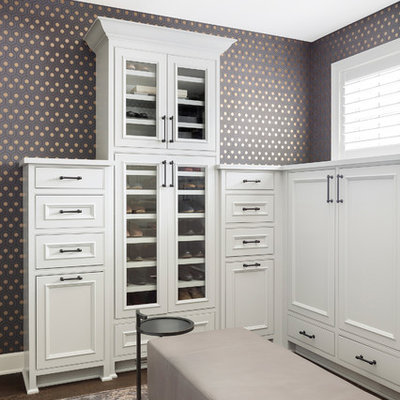 Example of a large transitional gender-neutral dark wood floor dressing room design in Minneapolis with recessed-panel cabinets and white cabinets