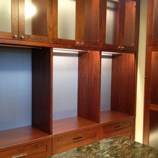 Contemporary Closet by SpartaCraft Custom Cabinets
