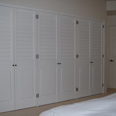 Traditional Closet by French Brothers Custom Shutters