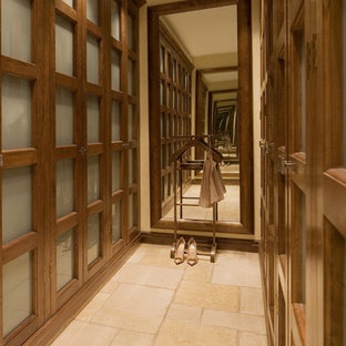 Inspiration for a contemporary walk-in wardrobe in London with travertine flooring.