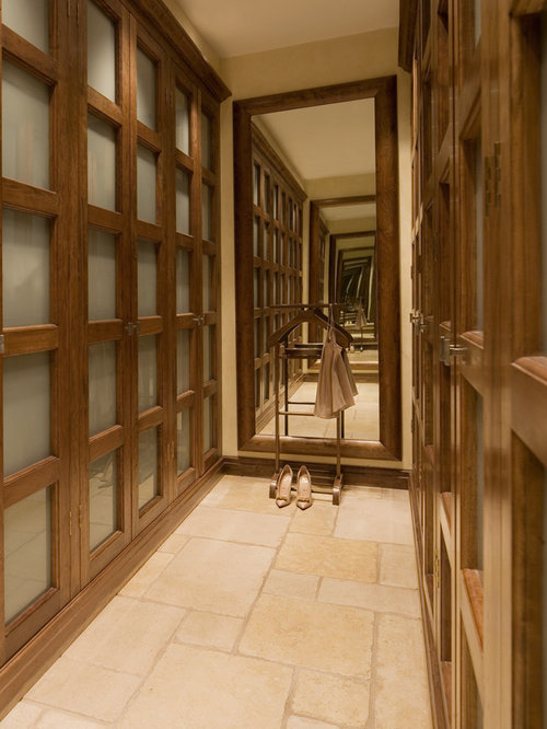 Inspiration For A Contemporary Travertine Floor Walk In Closet Remodel In  London