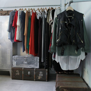Walk-in closet - industrial concrete floor walk-in closet idea in Other with open cabinets