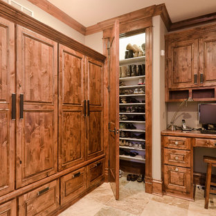 Inspiration for a traditional dressing room in Other with travertine flooring.