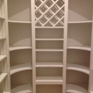 Inspiration for a medium sized contemporary gender neutral walk-in wardrobe in Austin with open cabinets, white cabinets, travertine flooring and beige floors.