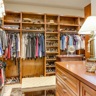Large transitional women's marble floor and white floor dressing room photo in Austin with raised-panel cabinets and medium tone wood cabinets