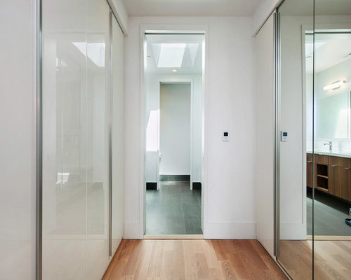 mirrored closet doors. Walk-in Closet - Mid-sized Modern Gender-neutral Light Wood Floor And Mirrored Doors
