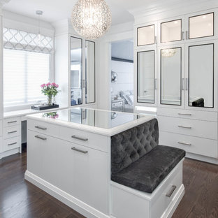 Inspiration for a transitional women's dark wood floor and brown floor dressing room remodel in Toronto with white cabinets