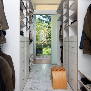 Modern walk-in wardrobe for men in Seattle with open cabinets and white cabinets.