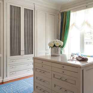 Elegant dressing room photo in Toronto with recessed-panel cabinets and beige cabinets