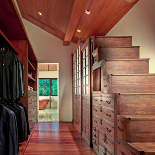 Design ideas for a large asian men's walk-in wardrobe in Miami with flat-panel cabinets, medium wood cabinets and medium hardwood floors.