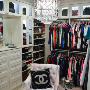 Design ideas for an expansive classic walk-in wardrobe for women in Tampa with recessed-panel cabinets, white cabinets, travertine flooring and beige floors.