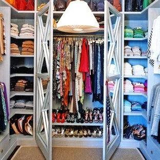 Large minimalist women's walk-in closet photo in Los Angeles