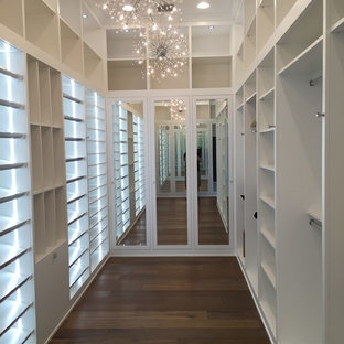 Example of a cottage chic closet design in Miami