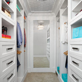Walk-in closet - transitional carpeted walk-in closet idea in Edmonton with shaker cabinets and white cabinets