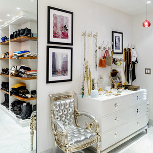 Inspiration for a contemporary women's walk-in closet remodel in Seattle with flat-panel cabinets and white cabinets