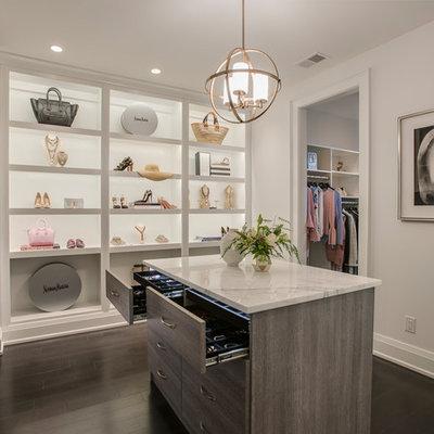Transitional women's dark wood floor and brown floor dressing room photo in Philadelphia with open cabinets