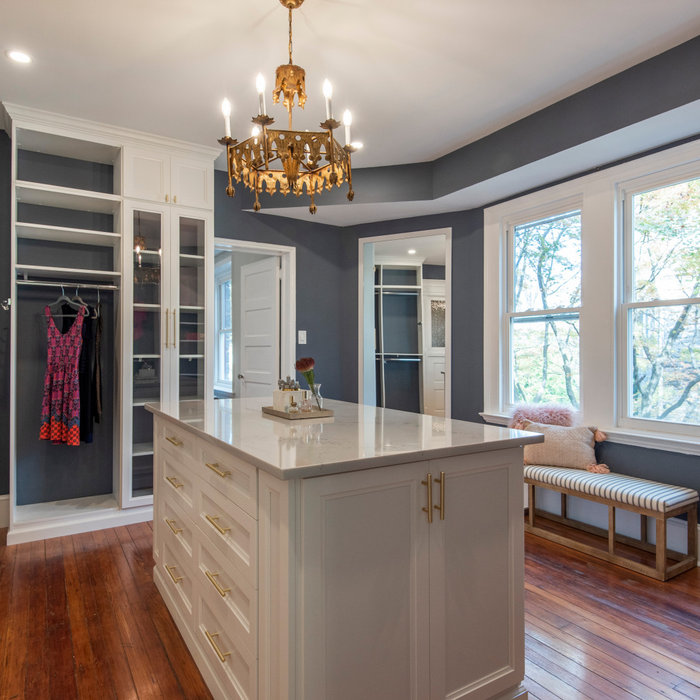 Large transitional gender-neutral vinyl floor dressing room photo in Philadelphia with shaker cabinets and white cabinets