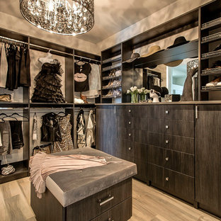 Dressing room - large contemporary gender-neutral dressing room idea in Vancouver with flat-panel cabinets and dark wood cabinets