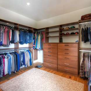Walk-in closet - contemporary gender-neutral medium tone wood floor and orange floor walk-in closet idea in San Diego with flat-panel cabinets and medium tone wood cabinets