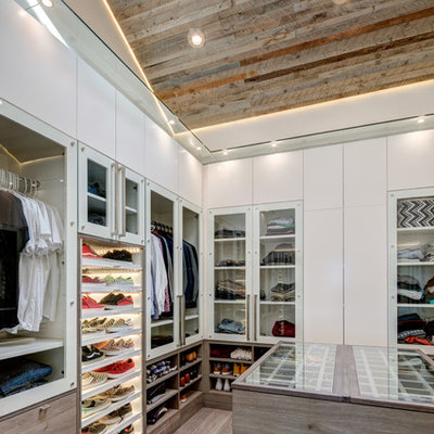 Inspiration for a contemporary men's dark wood floor and beige floor walk-in closet remodel in Salt Lake City with flat-panel cabinets and white cabinets