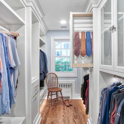 Walk-in closet - traditional men's medium tone wood floor walk-in closet idea in New York with white cabinets
