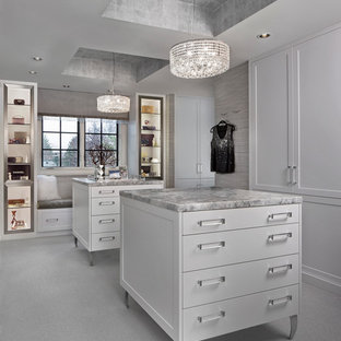 Inspiration for a mid-sized transitional women's carpeted dressing room remodel in Detroit with white cabinets and recessed-panel cabinets