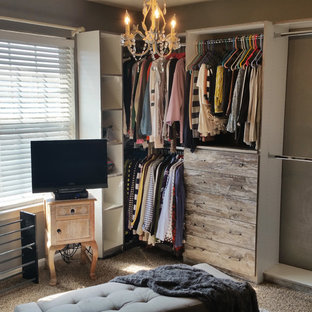 Photo of a small shabby-chic style gender-neutral built-in wardrobe in Los Angeles with flat-panel cabinets, distressed cabinets, carpet and beige floor.
