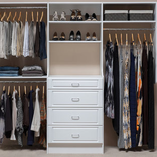 Mid-sized contemporary women's built-in wardrobe in Boston with raised-panel cabinets, white cabinets and carpet.