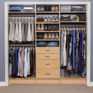 Small trendy gender-neutral carpeted reach-in closet photo in Boston with flat-panel cabinets and light wood cabinets