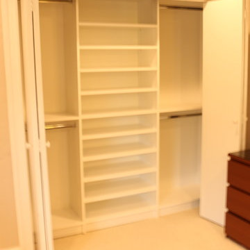 Reach-in Closet with Backing to cover up Damaged Wallpaper