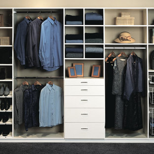 Design ideas for a mid-sized built-in wardrobe in Miami with flat-panel cabinets, white cabinets, carpet and black floor.