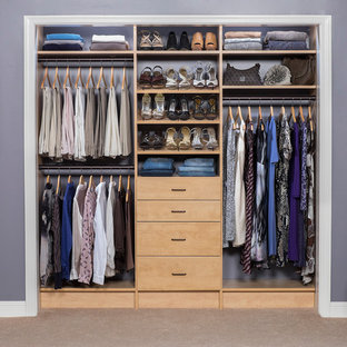 Small transitional women's built-in wardrobe in Phoenix with flat-panel cabinets, light wood cabinets and carpet.