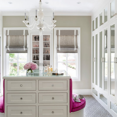 Example of a large transitional women's carpeted and gray floor walk-in closet design in Little Rock with recessed-panel cabinets and white cabinets