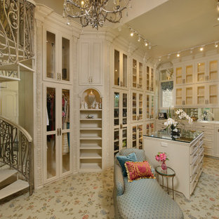 Example of a tuscan dressing room design in Houston with beige cabinets