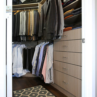 Inspiration for a mid-sized modern men's dark wood floor and brown floor walk-in closet remodel in Grand Rapids with flat-panel cabinets and light wood cabinets