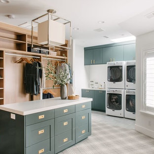 Inspiration for a large transitional gender-neutral dressing room in Salt Lake City with shaker cabinets, green cabinets, carpet and grey floor.