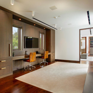Large minimalist brown floor closet photo in Miami with flat-panel cabinets and medium tone wood cabinets