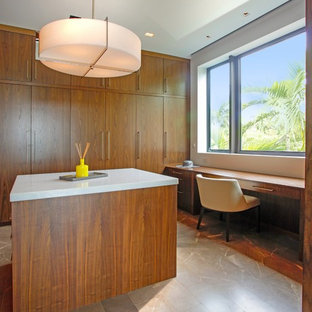 Closet - large modern closet idea in Miami with flat-panel cabinets and medium tone wood cabinets