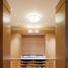 Modern Closet by Robert J Erdmann Design, LLC