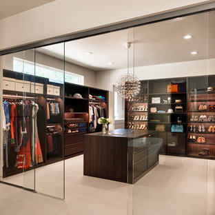 Inspiration for a contemporary dressing room for women in Austin with flat-panel cabinets and dark wood cabinets.